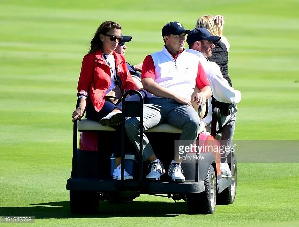 Jordan Spieth of the Unted States Team rides off on a golf cart with girlfriend Annie Verret as Davis Love III and Dustin Johnson look on after losing 4 and 3 to Louis Oosthuizen and Branden Grace of the International Team on the 15th green during the Friday four-ball matches at The Presidents Cup at Jack Nicklaus Golf Club Korea on October 9, 2015 in Songdo IBD, Incheon City, South Korea