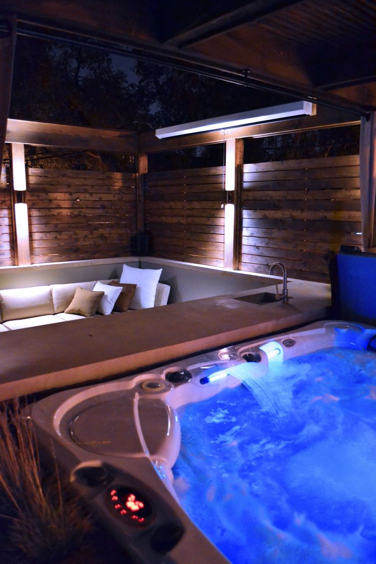 Hot Tub with Modern Pergola, Tropical Hardwood Decking and Fence Screening, Built-in Kitchen with Concrete countertop, Outdoor Seating, Lighting   Designed by Adam Miller