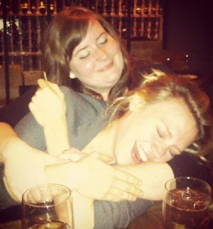Get in the middle of this cuddle session.    Aidy Bryant and Kate McKinnon.
