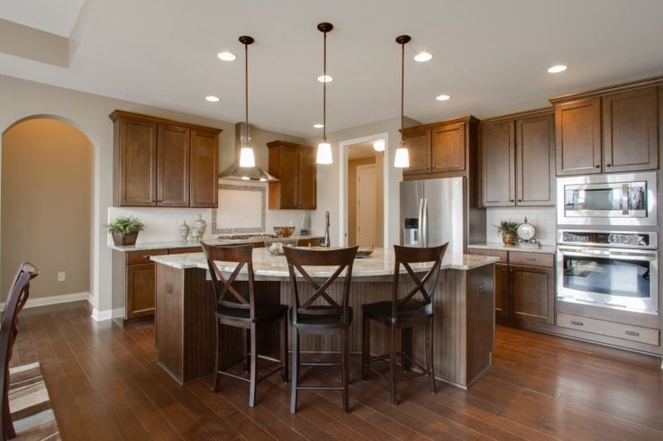 stunning stained wood cabinets with wood floors walls