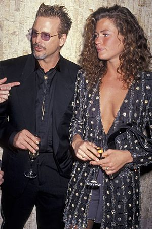 mickey rourke and carre otis  they were a hot couple back in the day before plastic surgery..