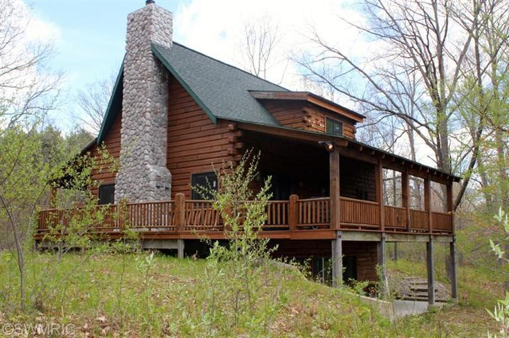 Quality built full log home with 1400 feet of river for Full wrap around porch log homes