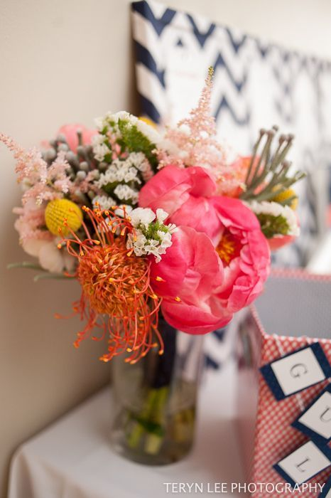 Coral peonies, pincushion portea, billy balls and dusty miller
