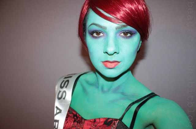 Kryolan aqua colours in turquoise and kelly green with Snazaroo body paint in pale green.