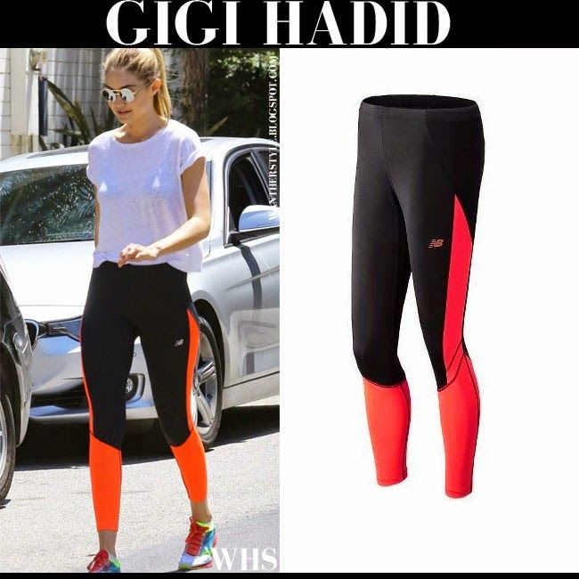 b01a7e8059ce3 Gigi Hadid in black and red New Balance leggings with Saucony neon sneakers  in Beverly Hills