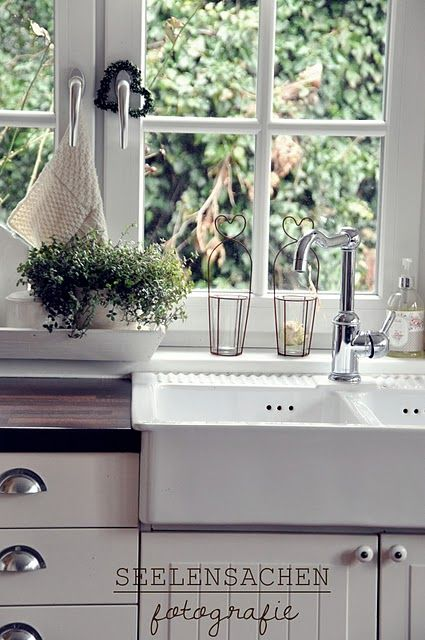 Perfect...that is our sink, just paint cabinets white, add bin pulls and butcher counter tops. Viola!