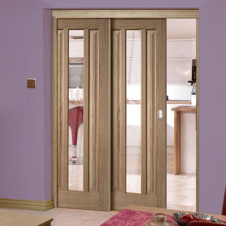 Twin Telescopic Pocket Kilburn 1L Oak Veneer Doors - Clear Glass.    #contemporarydoors #moderninteriordesign  #moderndoors  #hiddendoors  #pocketdoors  #door #doors #slidingddoors