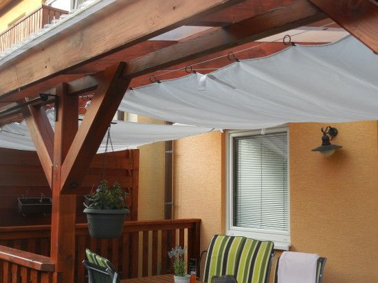 Canvas pergola IKEA Hack | Can use a lightweight cotton dropcloth or lengths of muslin or lightweight curtains along with the IKEA hardware to create a temporary awning for porches without them. :)