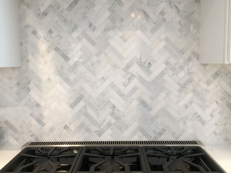 Herringbone backsplash. Carrera marble.