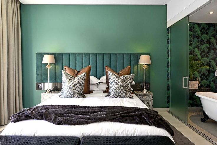 Luxurious emerald room at the Franschhoek Boutique Hotel.