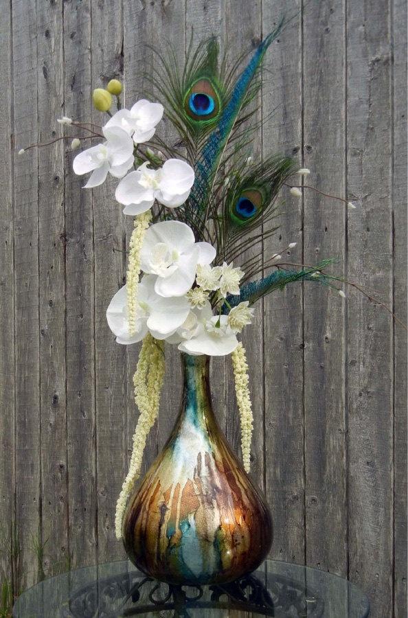 Peacock Floral Arrangements - Peacock White Orchid Flower Arrangement Brown and Blue Vase. $37.00, via Etsy.
