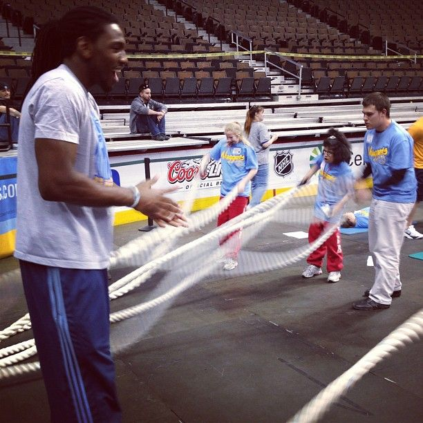 The Kenneth Faried encourages participants at the Special Olympics event with the Denver Nuggets at Pepsi Center.i LOVE this guy!