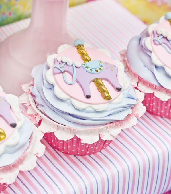 {Mary Poppins Theme} Jolly Holiday Dessert Table:– Detailed carousel horse fondant toppers with golden poles & jeweled saddles