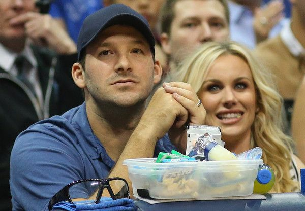Tony Romo Photos Photos - Tony Romo of the Dallas Cowboys and Candice Crawford watch a game between the Dallas Mavericks and the Houston Rockets at American Airlines Center on April 2, 2015 in Dallas, Texas.  NOTE TO USER: User expressly acknowledges and agrees that, by downloading and or using this photograph, User is consenting to the terms and conditions of the Getty Images License Agreement. - Houston Rockets v Dallas Mavericks
