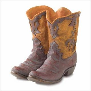 """$39.95 - Some boots were made for walking, but this pair is a playful planter that brings a merry spot of greenery to your """"home on the range""""."""