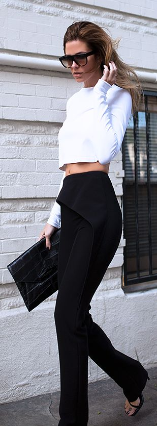 Jennifer Grace is wearing a white long sleeved crop top from Stella McCartney, black clutch from Givenchy, black trousers  from Balenciaga and the black sandals are from Saint Laurent