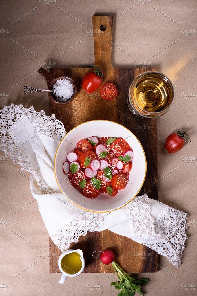 Fresh tomatoes and radishes salad by Iuliia Leonova on @creativemarket