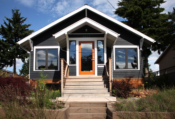 The original cedar siding was uncovered and painted a deep blue-gray. The front porch was rebuilt and a new ipe stoop was added.
