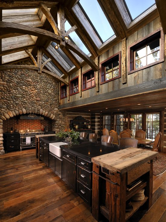 WOW!  Massive and beautiful ceiling trusses. Skylights are an amazing.