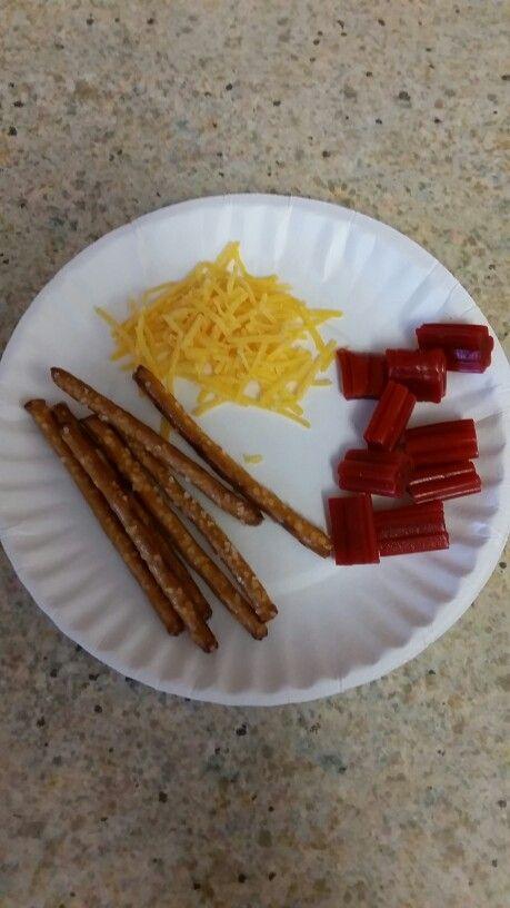 3 little pigs snack: shredded cheese, pretzel sticks and ...