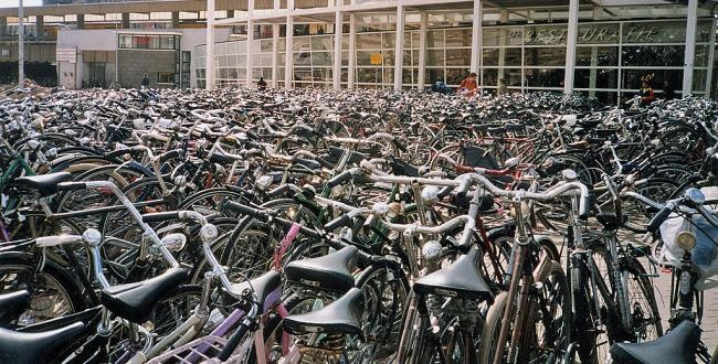 bicycles parked at train station in leiden holland. Black Bedroom Furniture Sets. Home Design Ideas