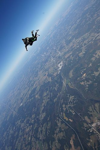 Skydiving - This frightens and excites me all at the same time... want to do this so badly!