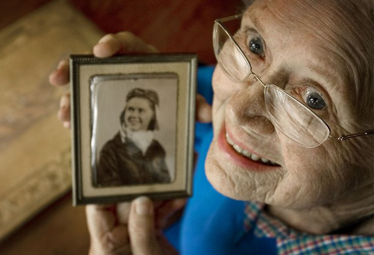 In this June 19, 2009 photo Susie Bain poses in Austin, Texas, with a 1943 photo of herself when she was one of the Women Airforce Service Pilots (WASPs) during World War II. Bain is one of 300 living WASP members that hoped at the time to be honored with the Congressional Gold Medal. The bill passed and on March 10, 2010, more than 200 WASP veterans attended a ceremony to be presented with the Congressional Gold Medal. (AP Photo/Austin American Statesman, Ralph Barrera)