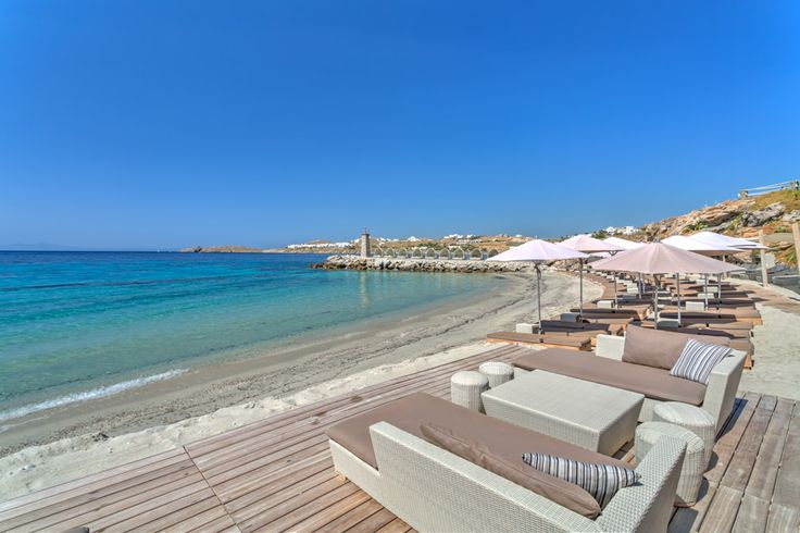 Blue sky, white clouds and a private silky sand beach with crystal clear water to relax in. Welcome at Santa Marina Resort & Villas, a Luxury Collection Hotel in #Mykonos ! #spg #luxurycollection #starwoodhotels #spglife