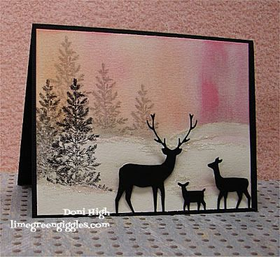 pink winter sunset card with silouetted deer family in black die cuts...tree stamped repeatedly makes a clever forest...