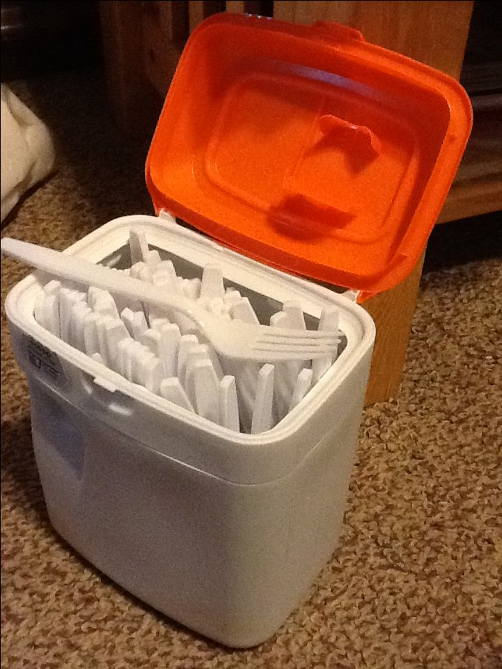 Similac baby formula containers hold plastic forks perfectly!