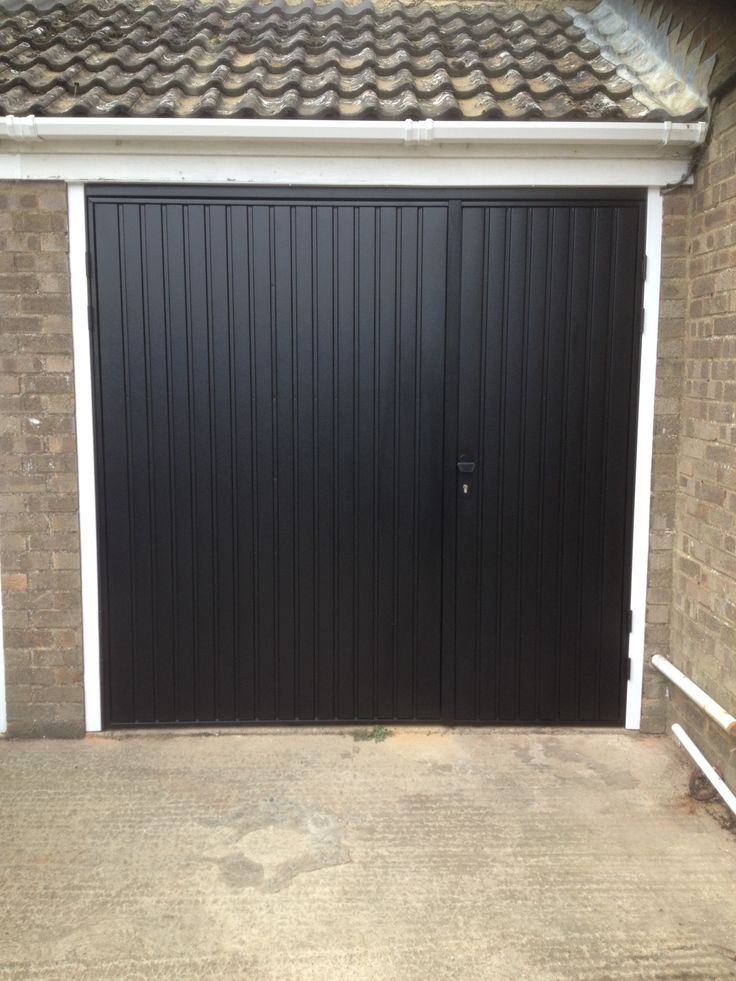 Cardale Novoferm Gemini Steel Side Hinged Garage Door One third/two third split for pedestrian access Fully Finished in Ebony Black with a White Frame Ten year warranty