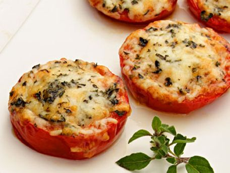 Checkout this easy low calorie side dish recipe for Cheesy Baked Tomatoes at LaaLoosh.com! Fresh and flavorful, these baked tomatoes make a great healthy side to any meal.