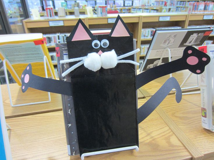 Splat the Cat Paper Bag Puppet: You will need a black paper lunch bag, black construction paper, pink construction paper, two googly eyes, two white pipe cleaners cut in half, two cotton balls, a glue stick and glue dots.