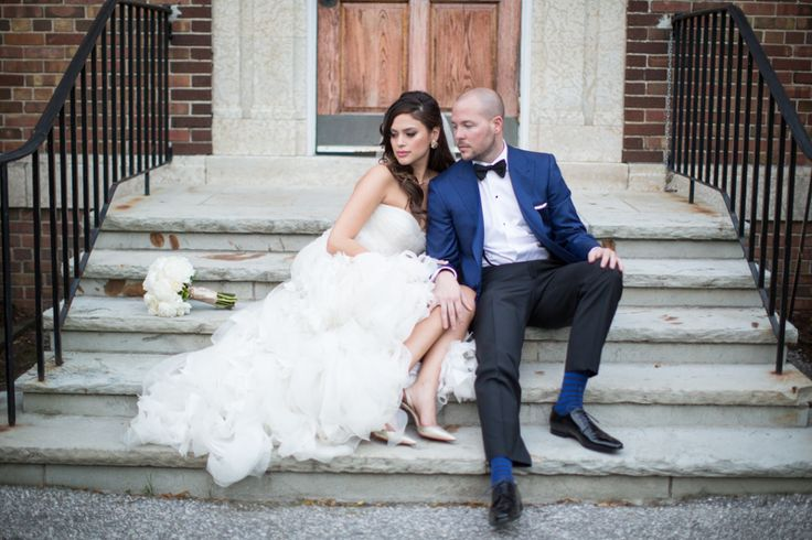 St. Andrew's College bride and groom on stairs