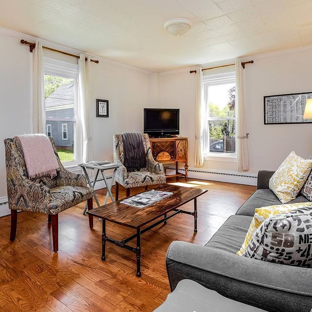 Our living room at Sadler House is the perfect family coastal Maine vacation getaway. Featuring a DIY plumbing pipe industrial coffee table and our rescued and refinished vintage buffet, it combines old house decor and modern convenience for perfect relax