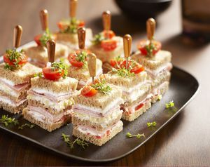 Savory petit fours - Brood.net.  The garnish on top is actually curly cress sprout tops.