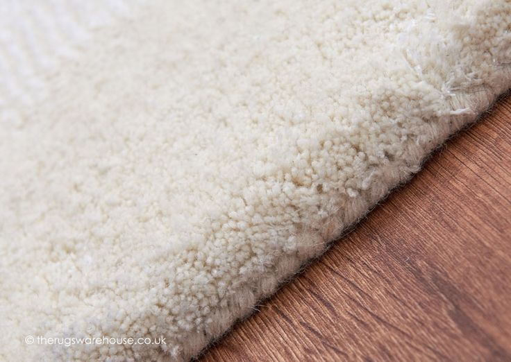 Aran Ivory Rug Texture Close Up A Luxurious Plain Hand Tufted