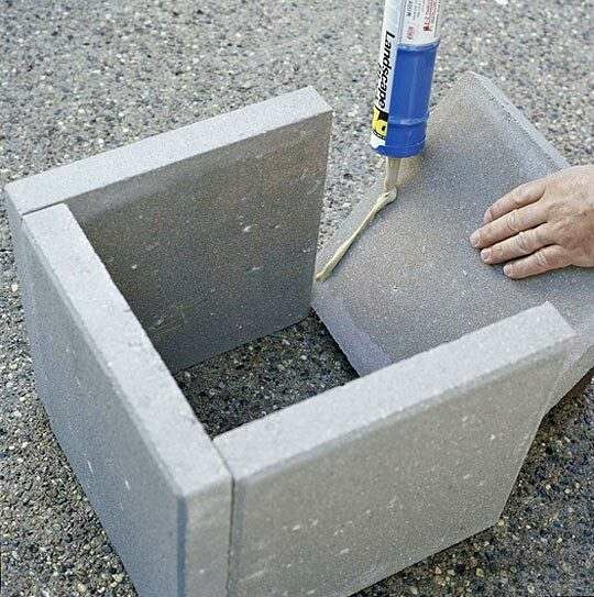 DIY garden planters. Concrete pavers and landscape block adhesive. Wait 24-hours and your new planters are ready.
