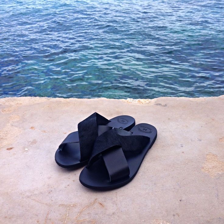 Minimalistic aesthetics: Original Greek leather sandals slides found at www.nympheswimwear.com