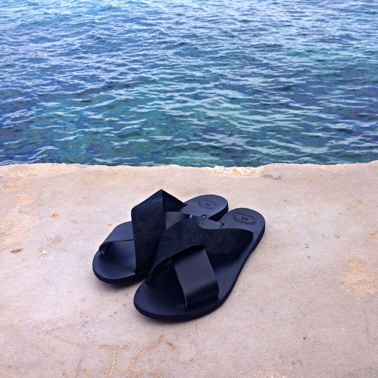 Minimalistic aesthetics: Original Greek leather sandals slides found at www.nympheswimwear.com