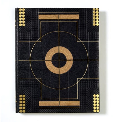 Binding for Histoire du chien de Brisquet, written by Charles Nodier (published by Pelletan, Paris, 1900) by Pierre Legrain. Dark blue leather with fawn onlays, gold and blind tooling, 1950 after earlier design by Pierre Legrain.