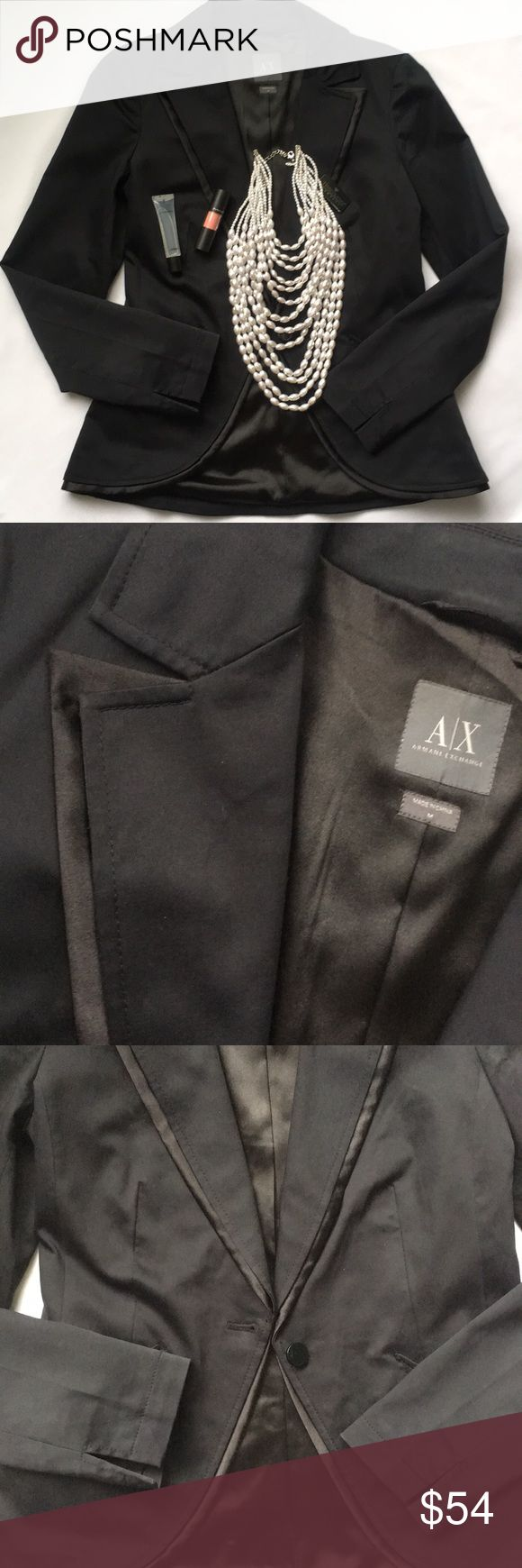 A/X Armani Exchange jacket Accentuates the female silhouette. Rock as formal wear or pair with black leggings for an evening out. Fitted, dark navy with subtle black layers around collar and jacket bottom. Sized medium but fits like a 6 to me. In excellent condition. A/X Armani Exchange Jackets & Coats