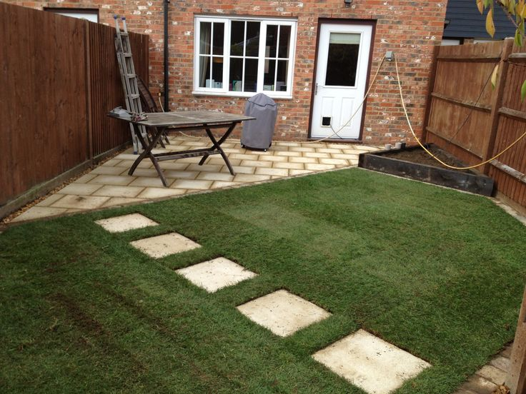 Small Garden Patio Incorporating Stepping Stone Path, Freshly Laid Turf And  Some New Lap Panels