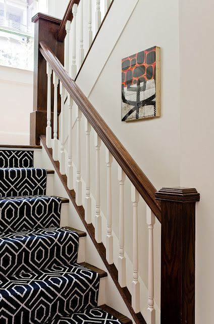 climbing all four stories of the house the graphic stair runner forms a unifying backbone