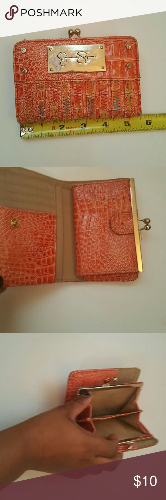 Jessica Simpson Orange Wallet Okay condition  A few black marks  I'm no longer interested in using the wallet.  Jt needs a new home! Jessica Simpson Bags Wallets