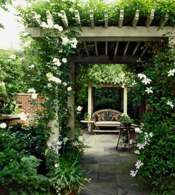 Multiple Pergolas  A small yard can benefit from the added height of a pergola-or more. Here, matching pergolas spaced a couple yards apart are framed with lush greenery; slate pavers that stretch under create a seamless look.  More than one is always a good thing!
