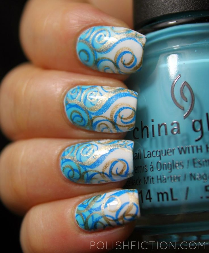 gradient with China Glaze Capacity to See Beyond and white polish. Then I stamped the swirly image from CICI&SISI's plate 05 first with Konad's blue stamping polish and then with China Glaze Passion.