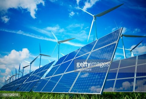 Stock Photo : Wind turbines and solar plates making green energy