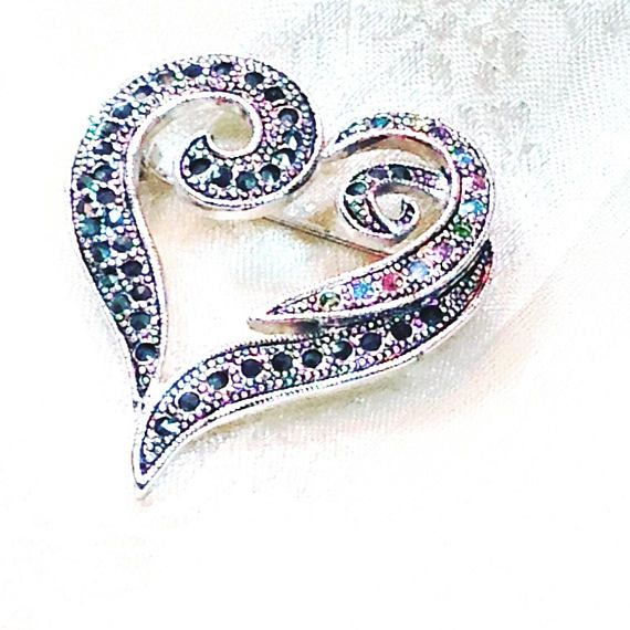 Vintage Crystal Heart Brooch, Estate Jewelry From NorthCoastCottage Jewelry Design & Vintage. This graceful heart brooch is encrusted with marcasite and a flourishing swirl of multicolored Austrian crystals that sets it apart from every other sparkly heart brooch. Perfect size on
