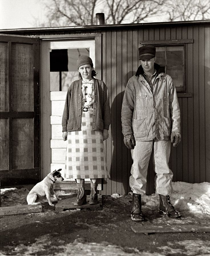 And Their Little Dog, Too: December 1936. Mr. and Mrs. Marcus Miller and dog. Spencer, Iowa. 35mm negative by Russell Lee for the Resettlement Administration.